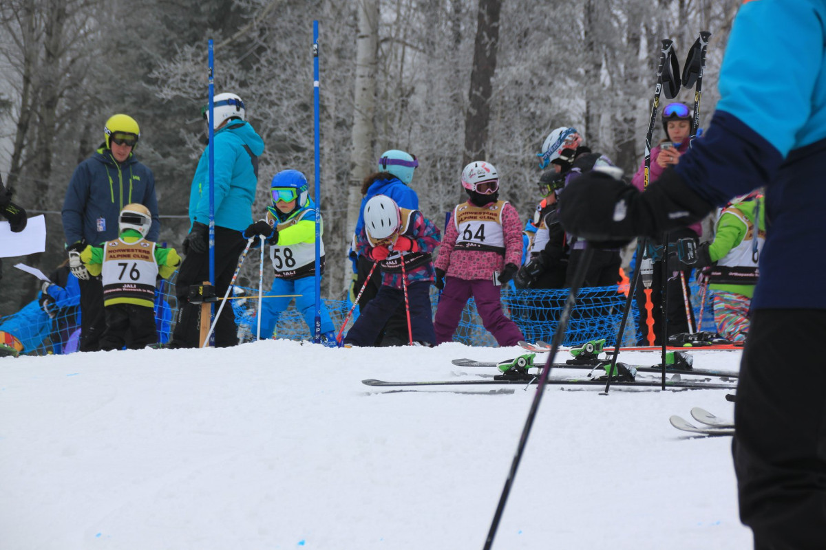 Children on Skis at Starting Line Wearing Race Numbers