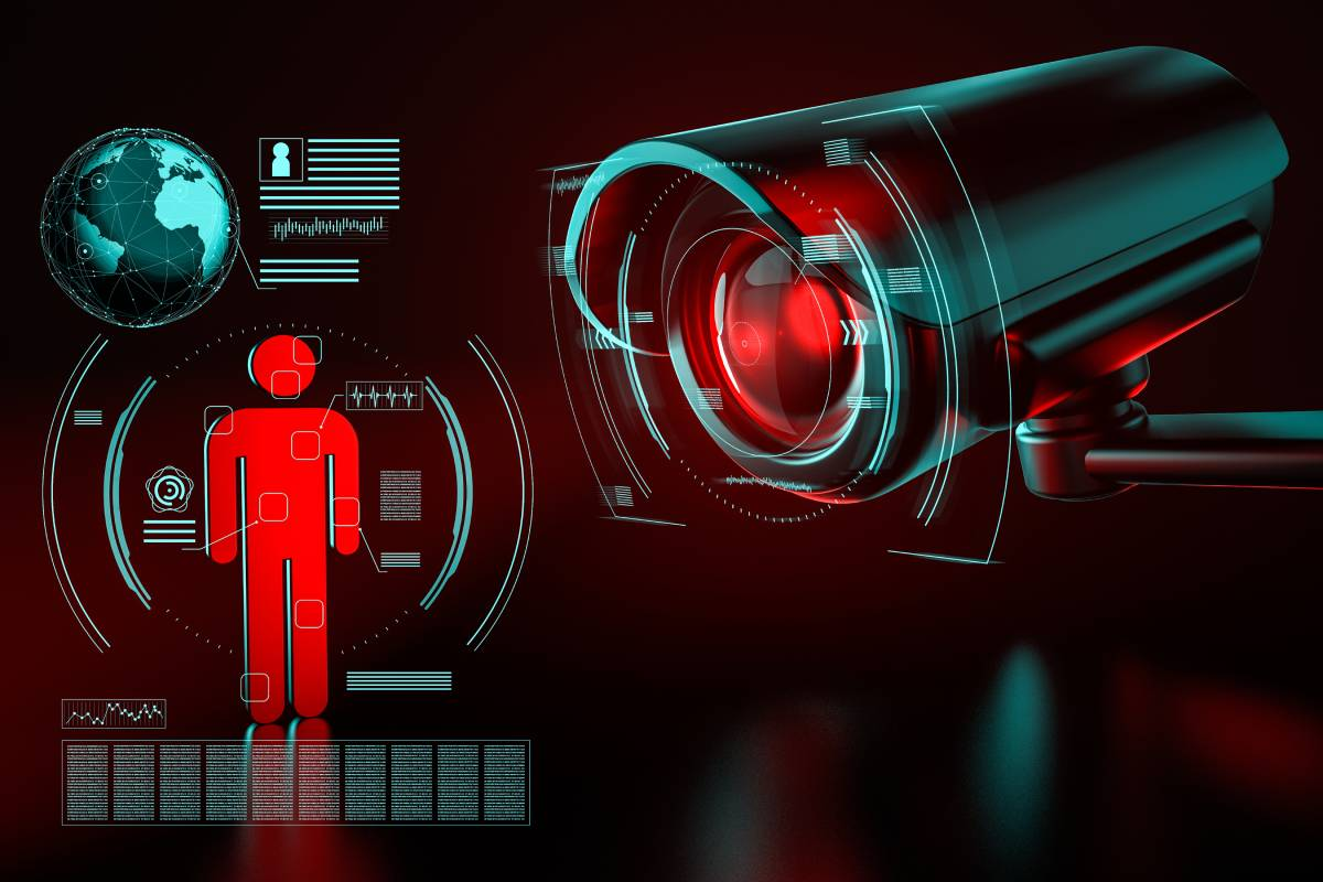 A temperature scanning camera pointing at a red human shape